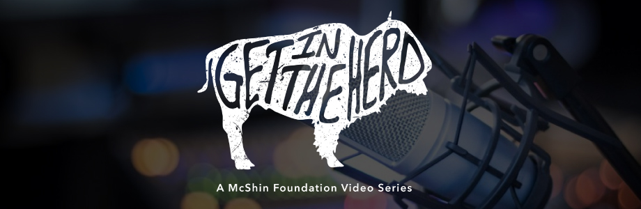 Get in the Herd logo on background with a microphone